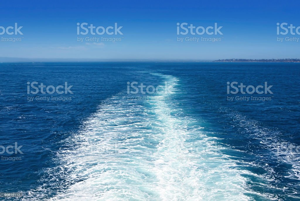 View of a boat wake on blue sea royalty-free stock photo