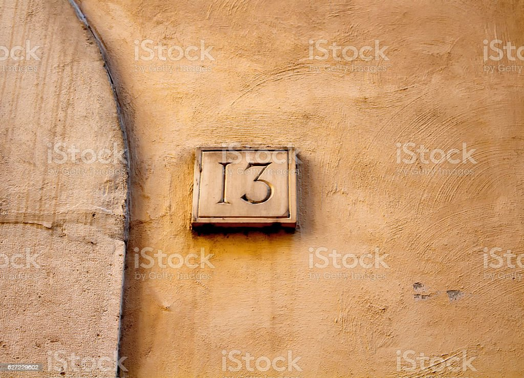 View of a building number (13) in Rome. stock photo