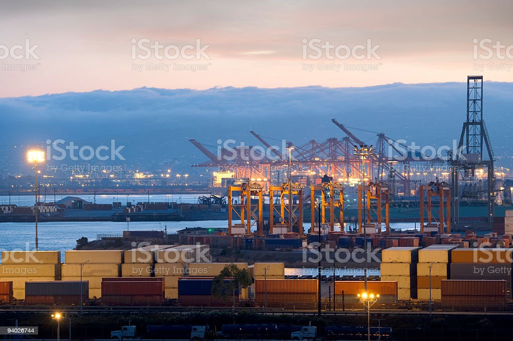 View of a busy harbor with cranes and containers stock photo