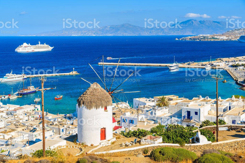 A view of a famous windmill in Mykonos port, Cyclades islands, Greece stock photo