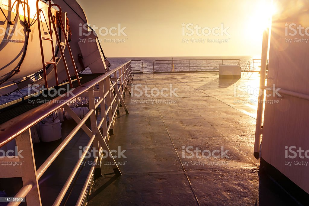 View of a ferry deck in the evening sunshine stock photo