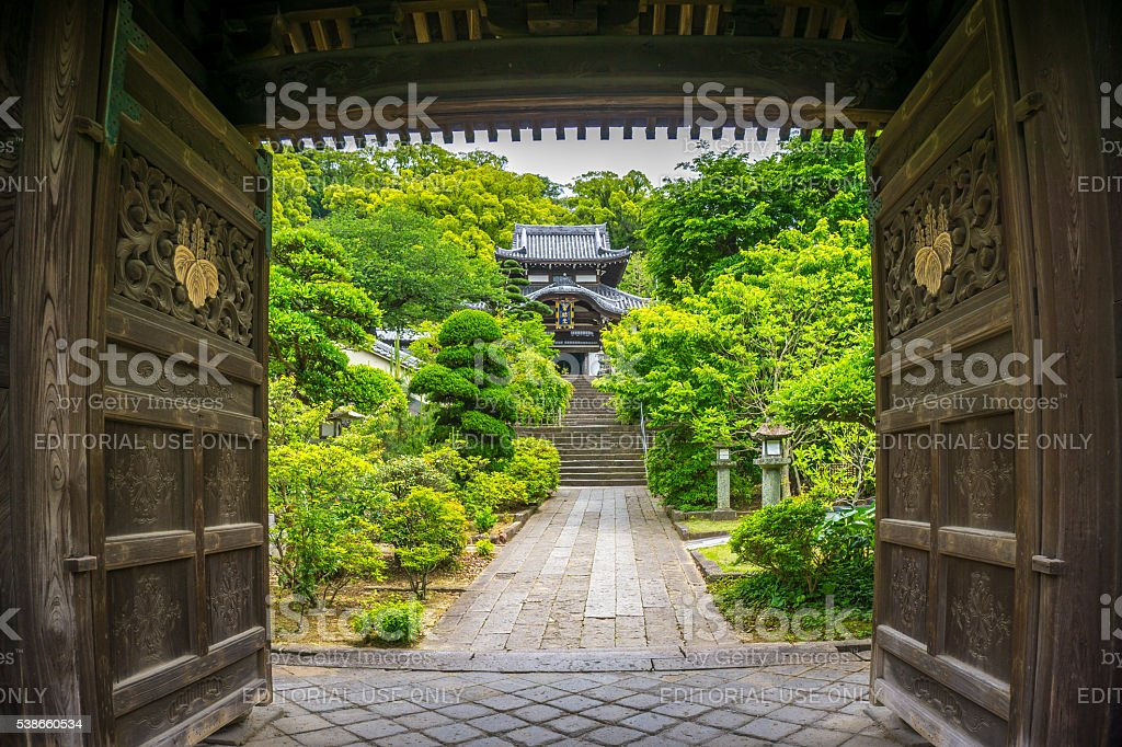 View of a Japanese temple beyond its wooden gates stock photo