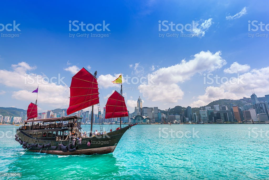 View of a junk boat in Hong Kong city stock photo