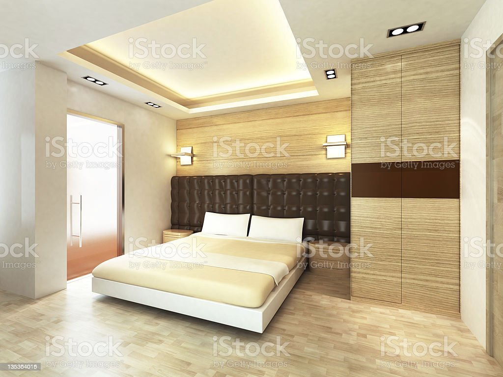 A view of a modern bedroom with light tones royalty-free stock photo
