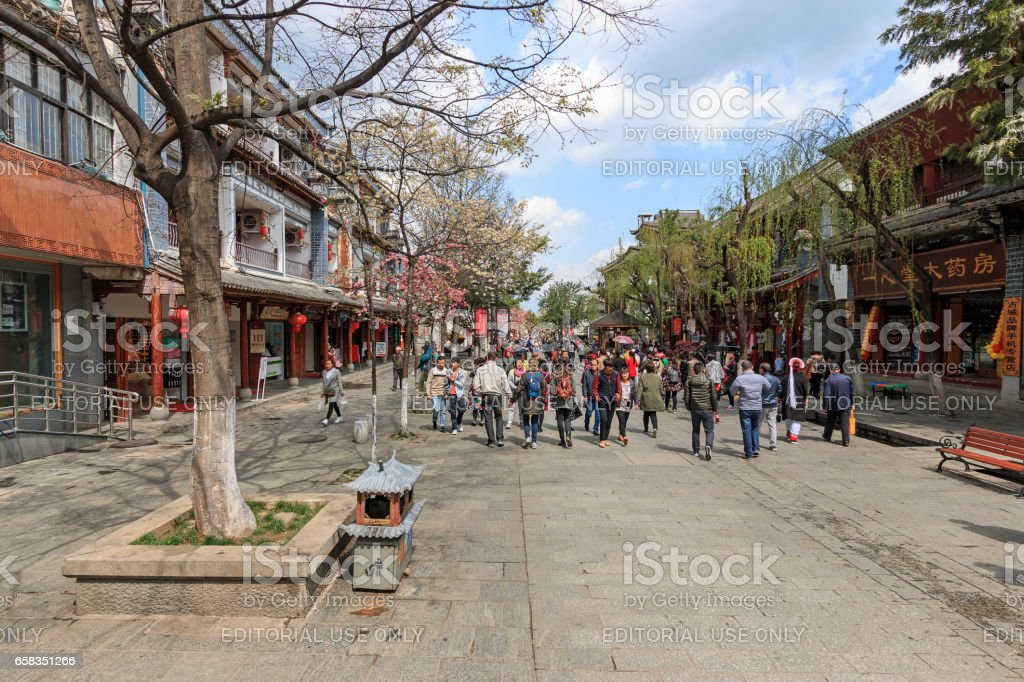 View of a narrow street and tourists in the old town of Dali in Yunnan, the ancient kingdom of Nanzhao stock photo