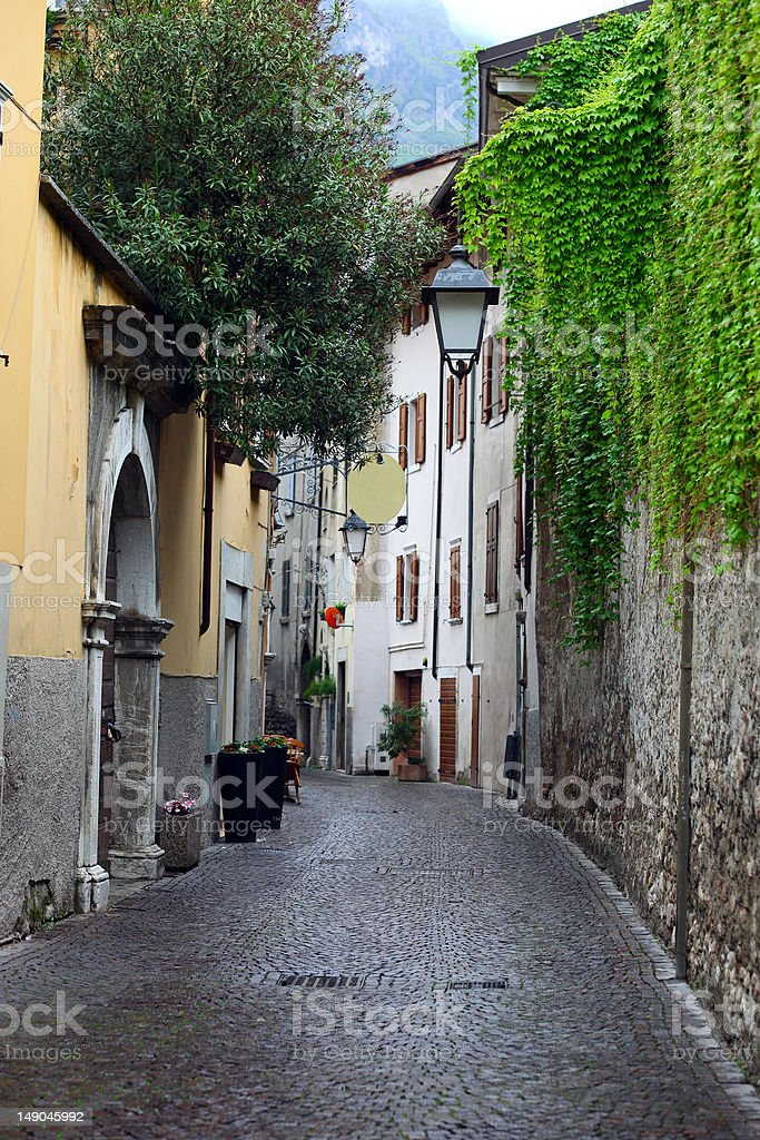 View of a narrow street in Arco, North Italy stock photo