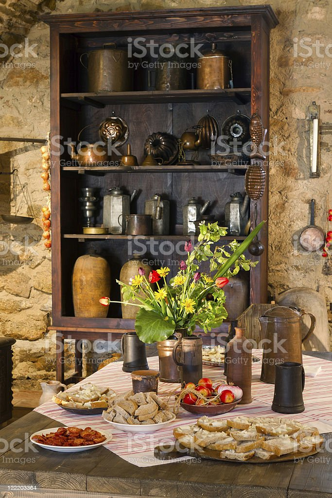 View of a old kitchen with food on the table royalty-free stock photo