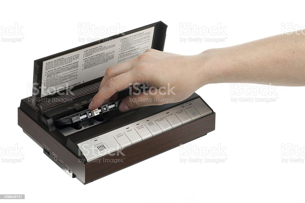 view of a person putting cassette inside player stock photo