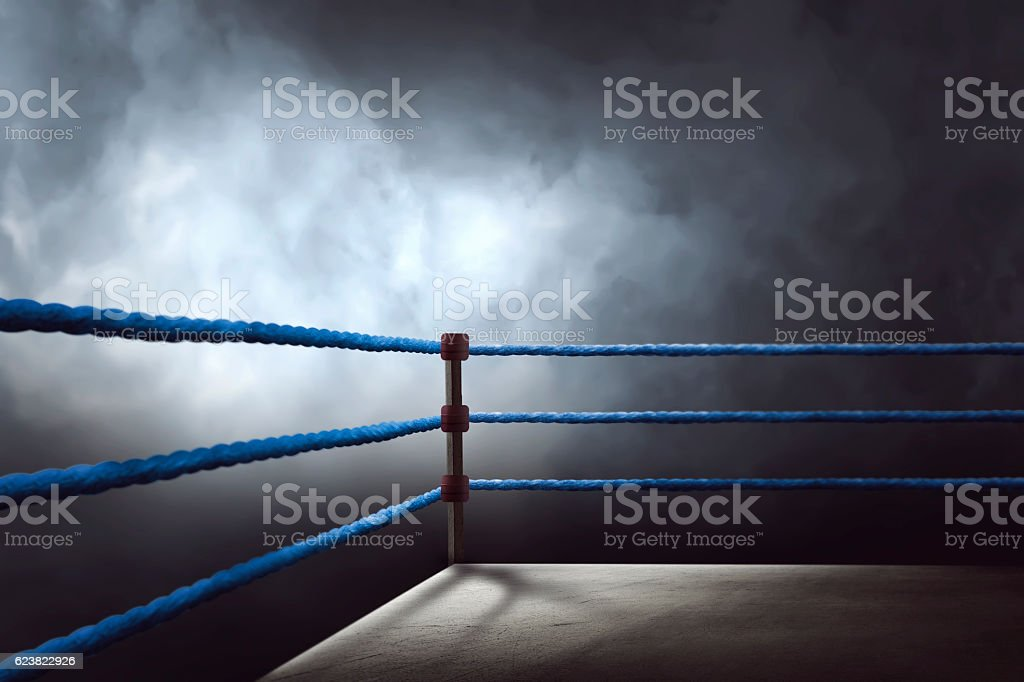 View of a regular boxing ring surrounded by blue ropes stock photo