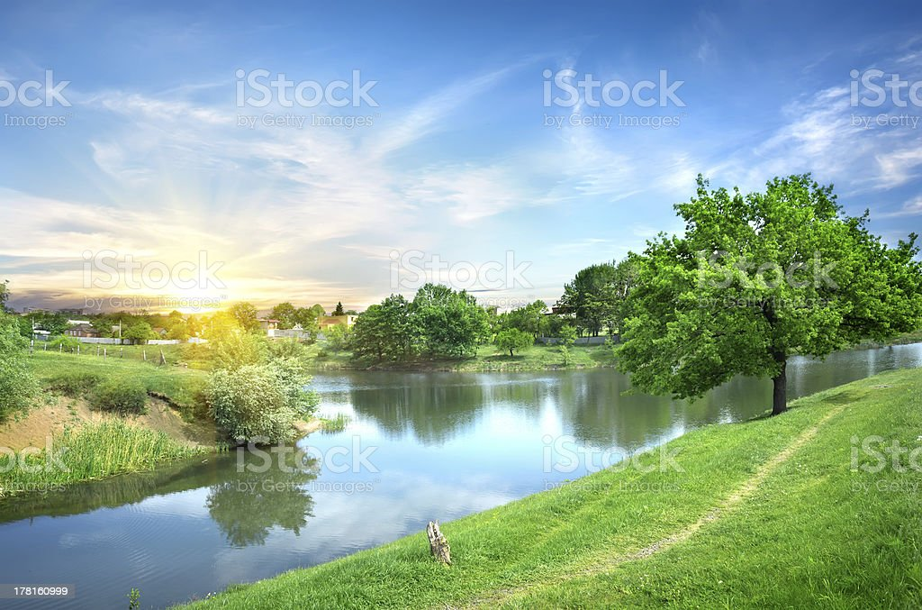 View of a river and green fields stock photo