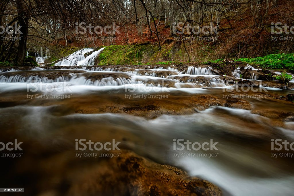 View of a river with an waterfall in the forest stock photo