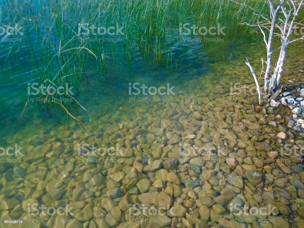 View of a rock bottom from a boat launch stock photo