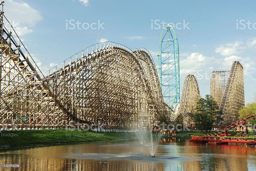View of a roller coaster park from a man made lake stock photo