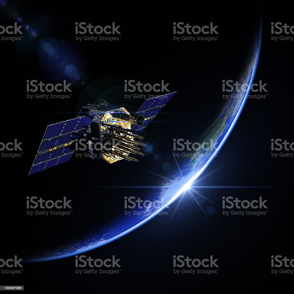 A view of a satellite during sunrise in space royalty-free stock photo
