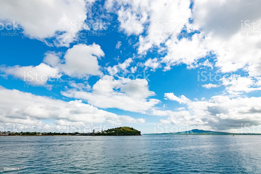 View of a volcanic island across the water stock photo