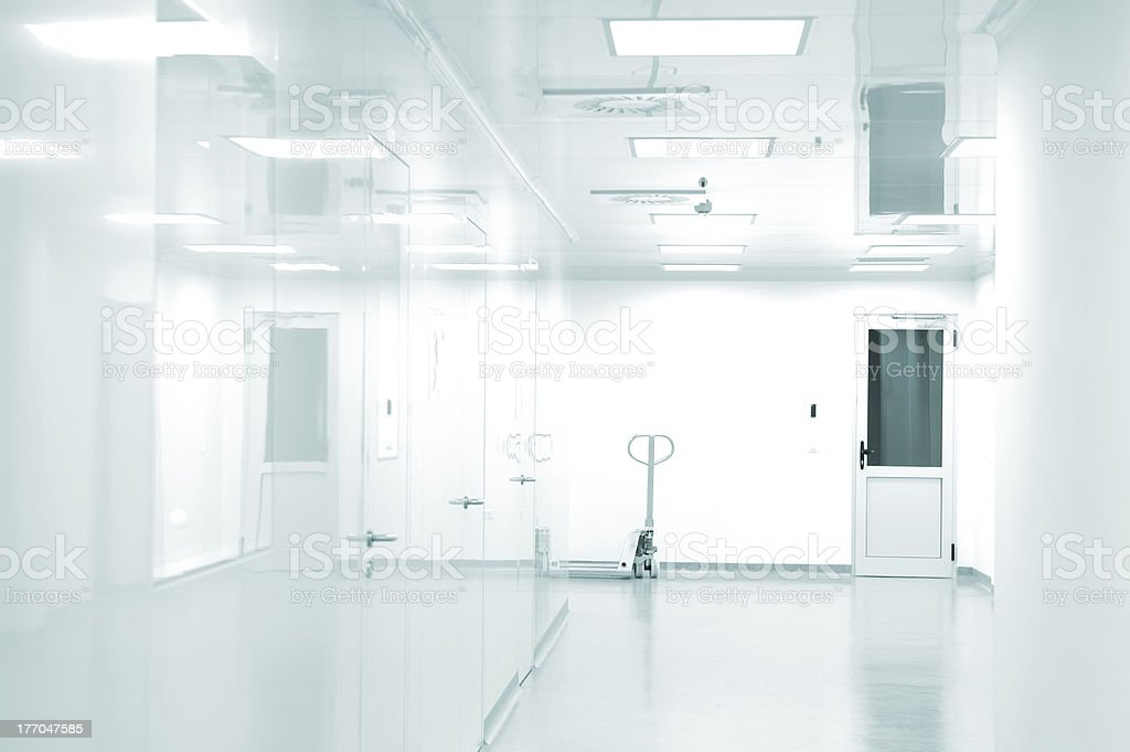 A view of a white corridor full of doors royalty-free stock photo