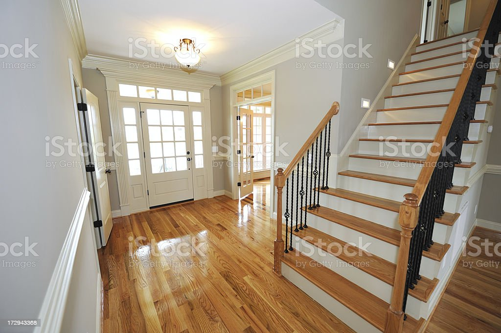 A view of a wooden foyer painted white royalty-free stock photo