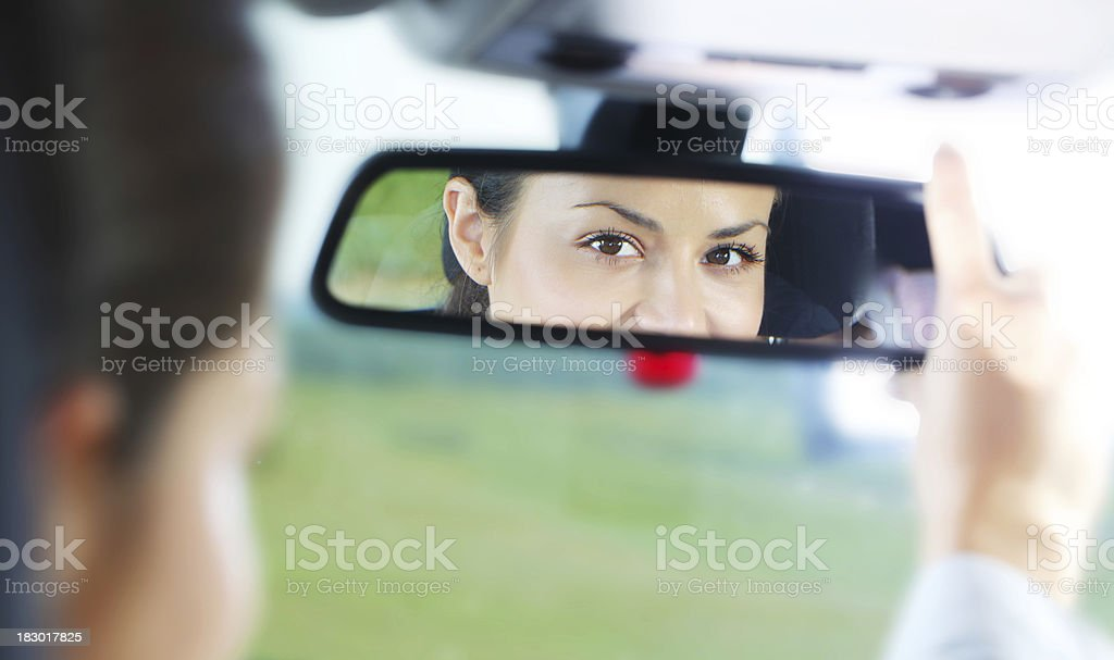 View of a young girl in the mirror. stock photo