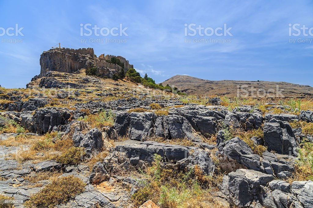 view of Acropolis  Lindos from rocks below. Rhodes Greece stock photo