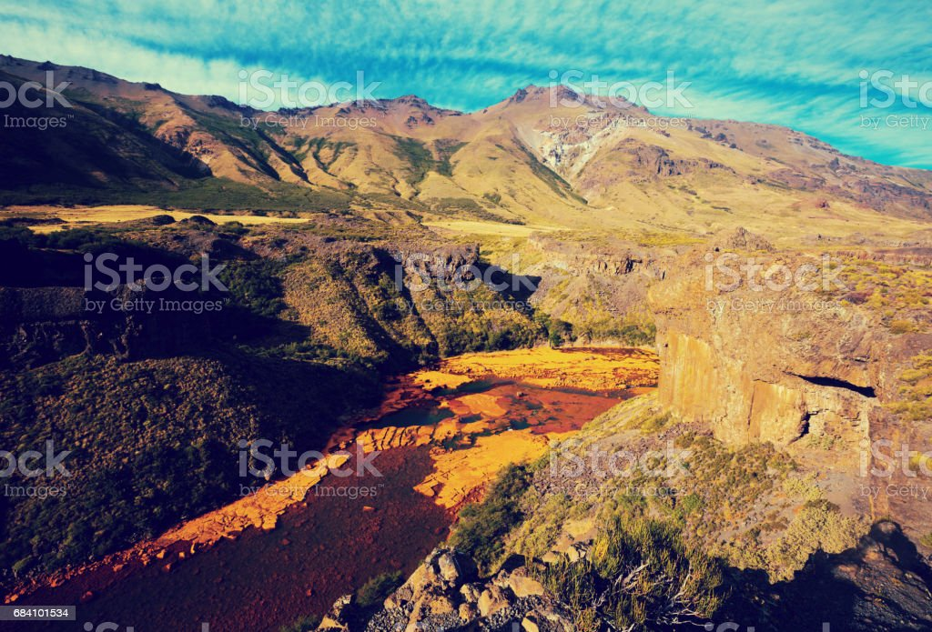 View of Agrio river near Salto del Agrio waterfall stock photo