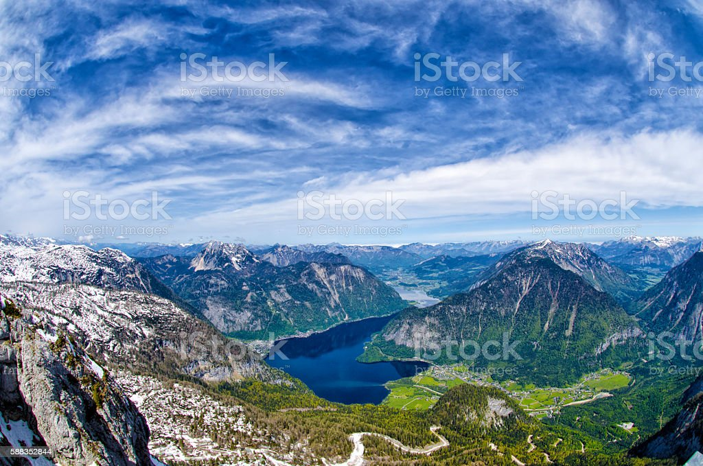 View of Alps mountains, snowy mountains peaks and Hallstattersee lake. stock photo