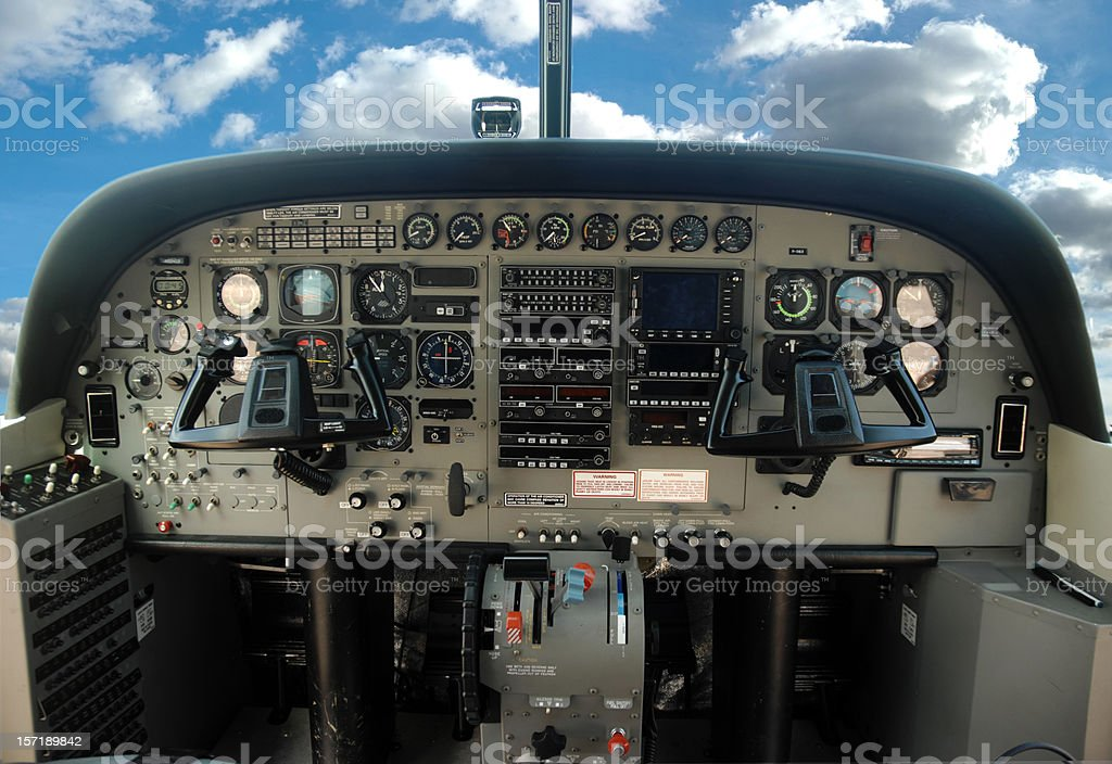 View of an airplane cockpit from the pilot's seat stock photo
