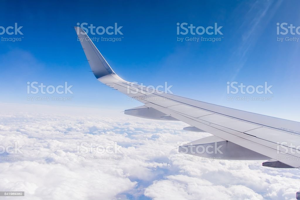 View of an Airplane Wing from Window Seat stock photo
