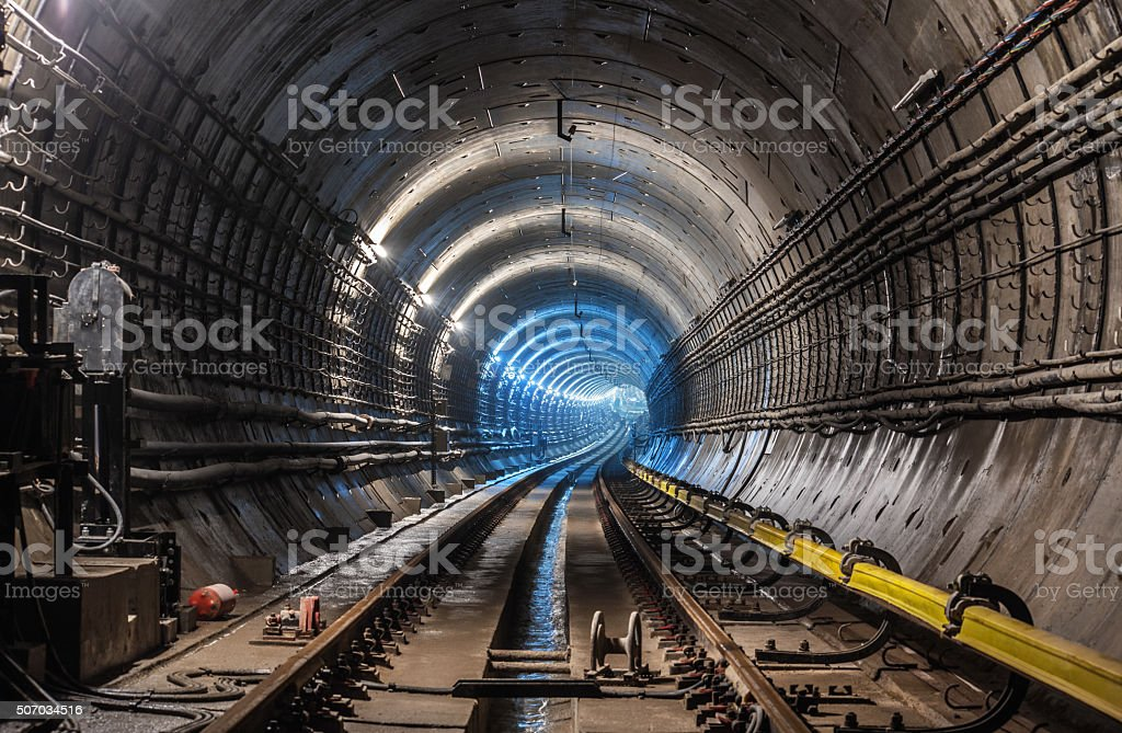 View of an empty subway tunnel under the ground stock photo