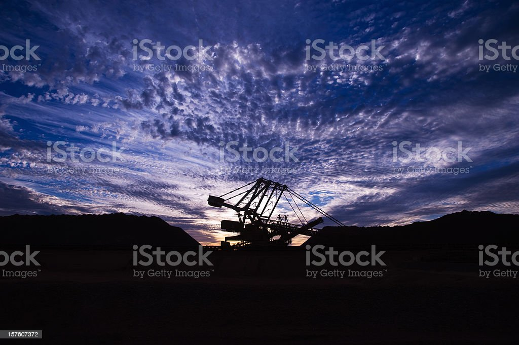 A view of an iron ore mine site at sunset stock photo