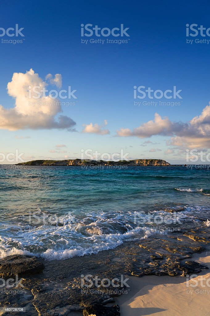 view of an island at sunset stock photo