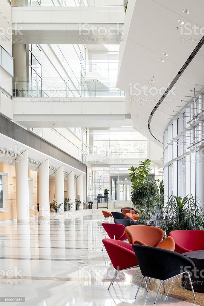 View of an office building lobby with colorful chairs royalty-free stock photo