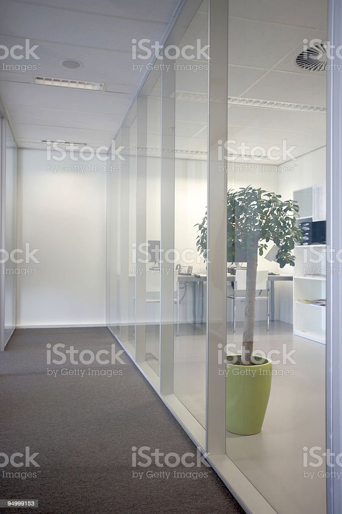 View of an office hallway with glass walls royalty-free stock photo
