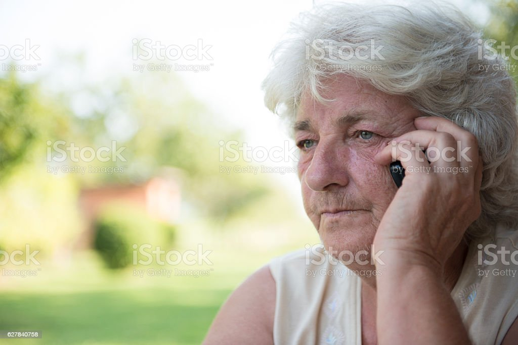 View of an  Old lady with mobile phone stock photo