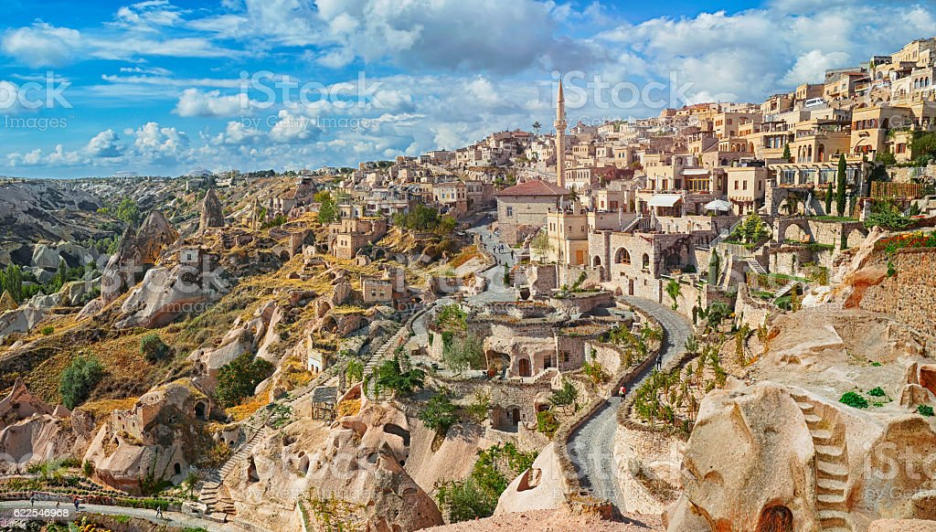 View of ancient Nevsehir cave town and  castle of Uchisar stock photo
