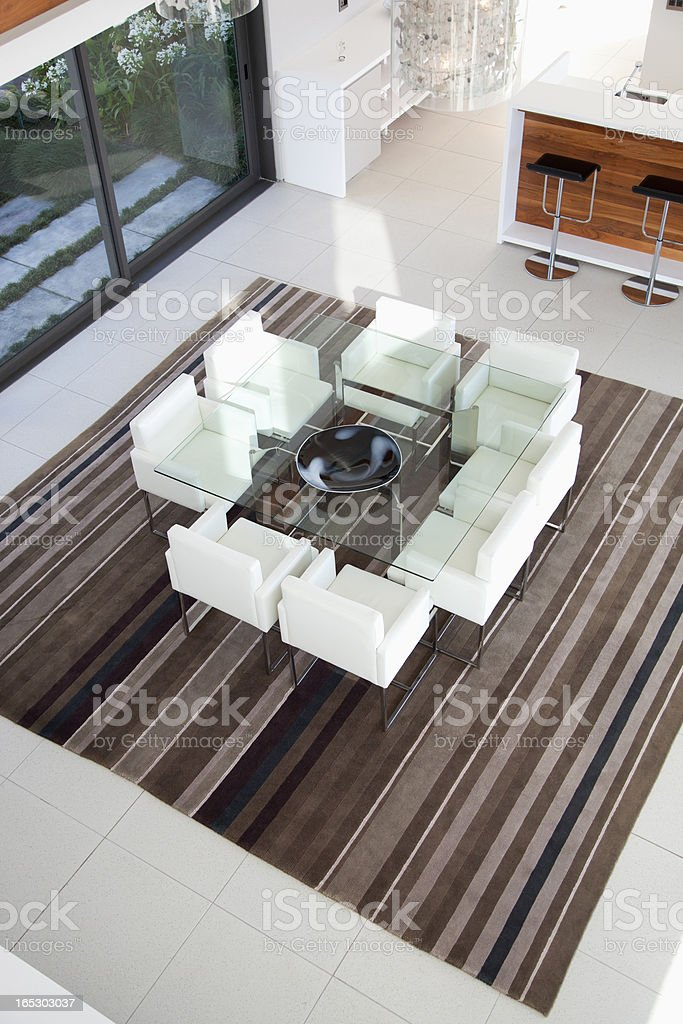 View of armchairs around table in modern dining room royalty-free stock photo