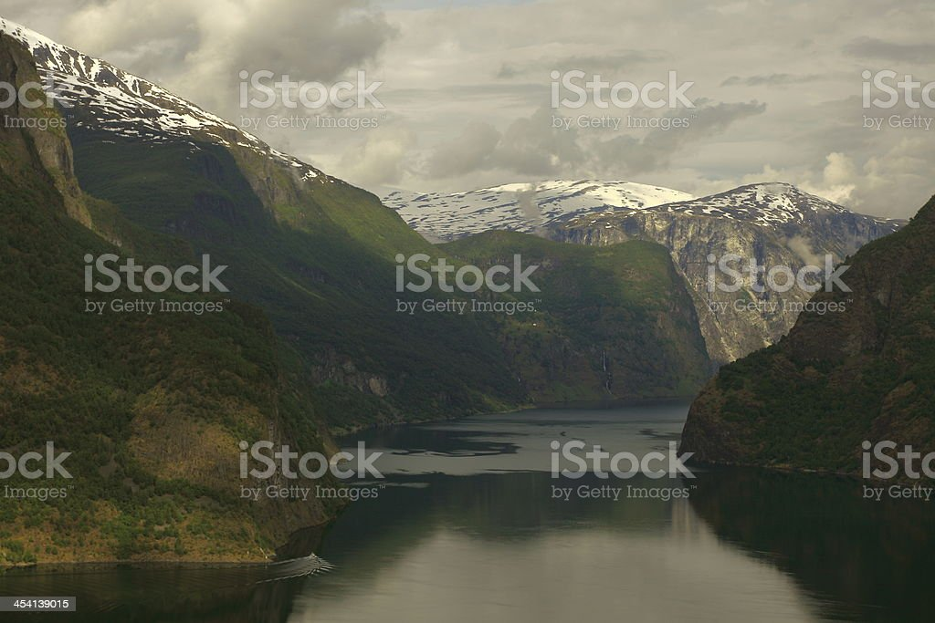 View of Aurland fjord at sunrise and boat, Norway, Scandinavia stock photo