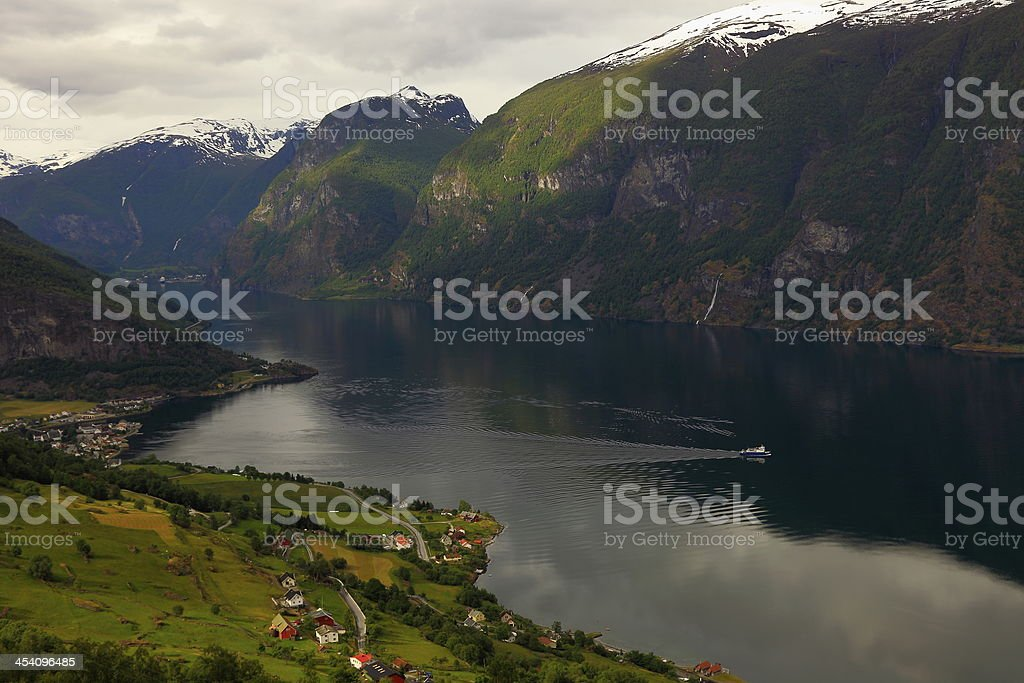 View of Aurland fjord at sunset and boat cruise, Norway stock photo