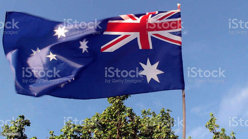 View Of Australian Flag Against Blue Sky stock photo