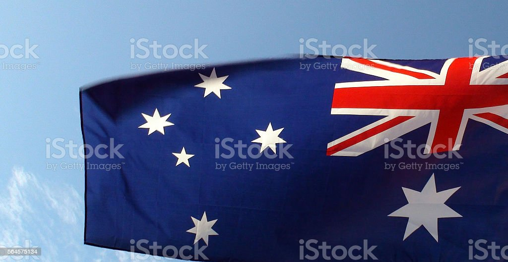 View Of Australian Flag And Blue Sky stock photo