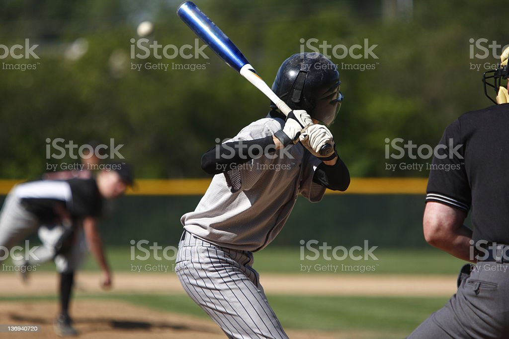 View of baseball batter from behind the catcher as they hit stock photo