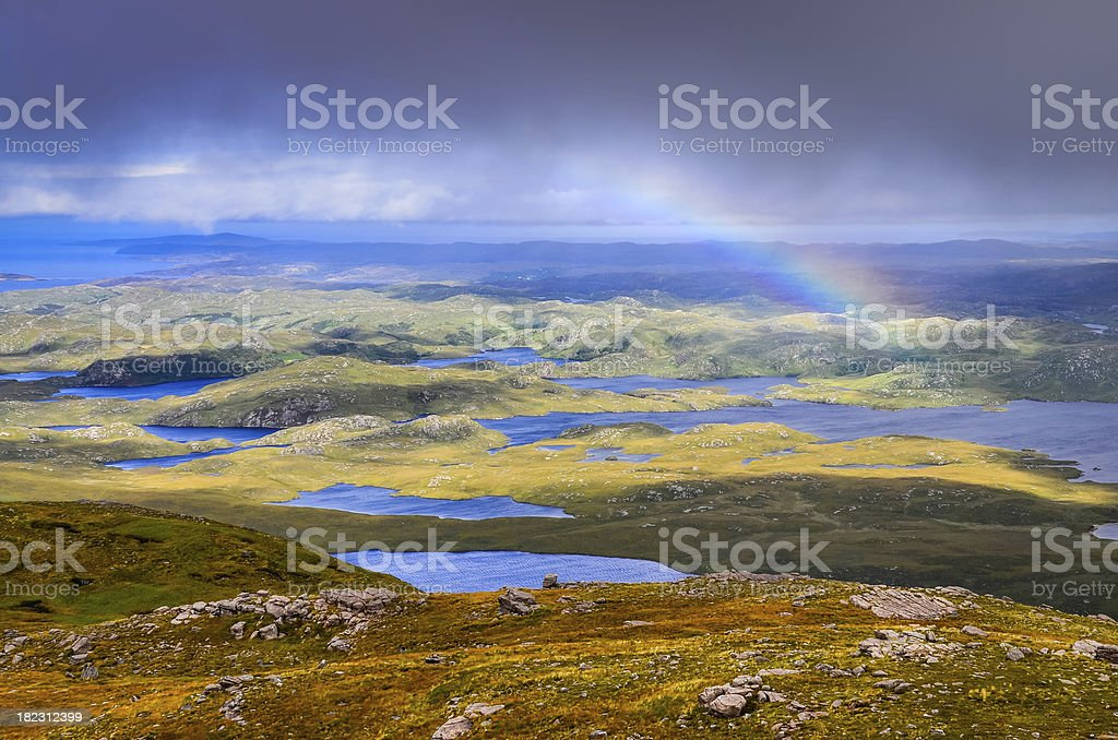 View of beautiful lakes, clouds and rainbow in Inverpolly, Scotland stock photo