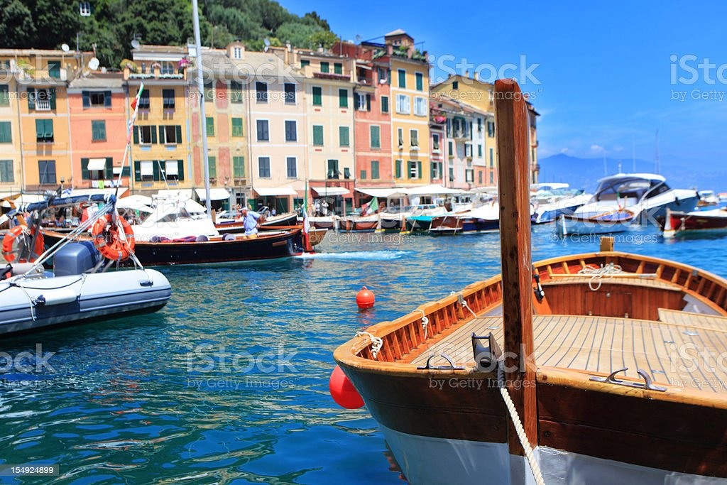 View of boats in Portofino with city in the background stock photo