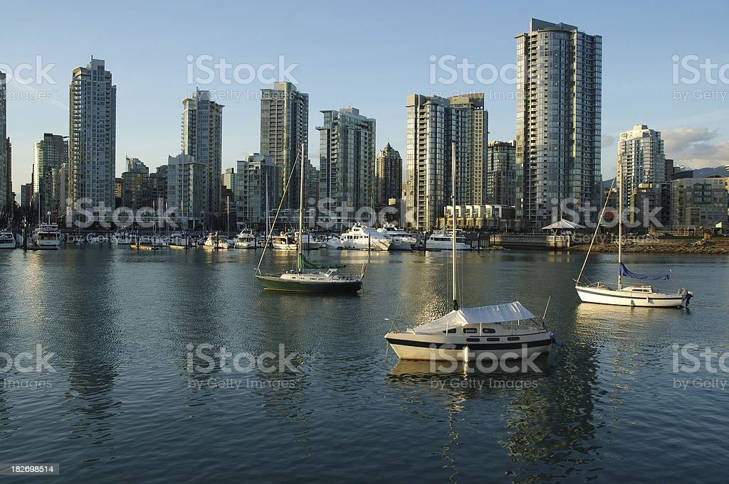 View of boats moored in False Creek stock photo