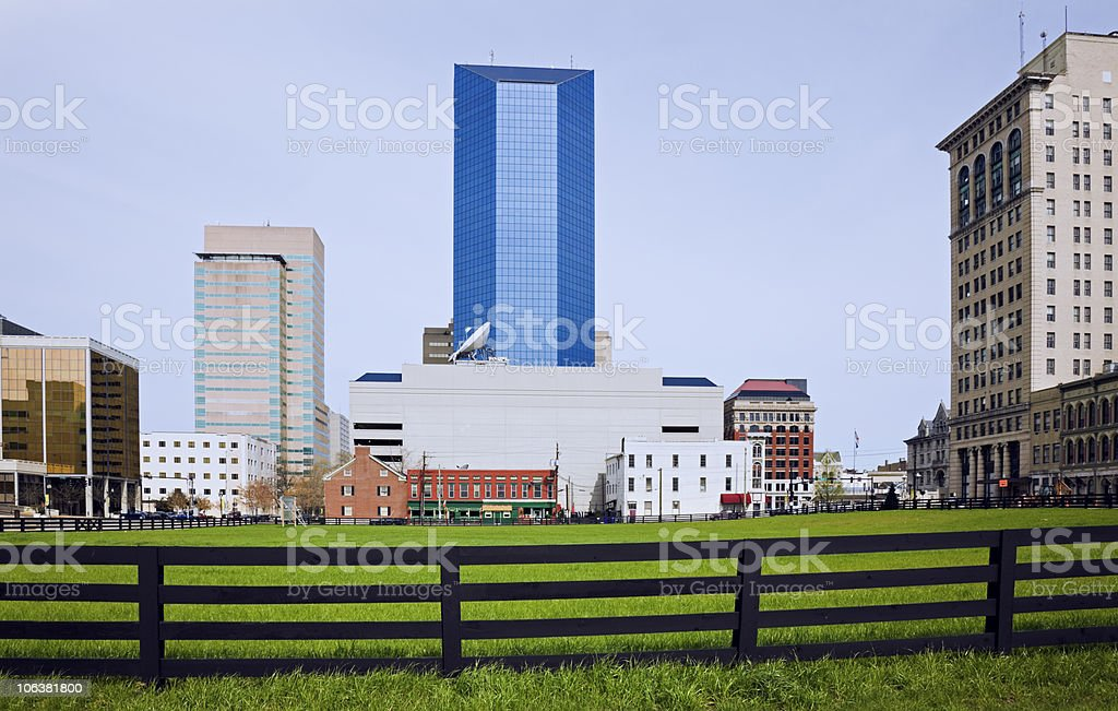 View of buildings behind green field in Lexington, Kentucky stock photo