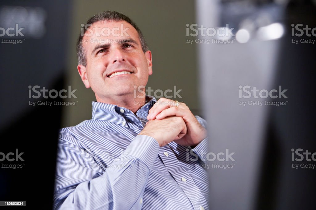 View of businessman between two computer monitors stock photo