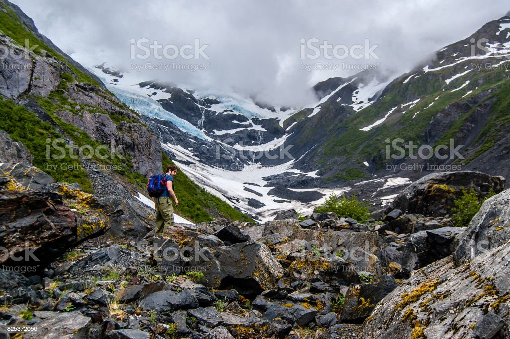 View of Byron glacier and a tourist stock photo