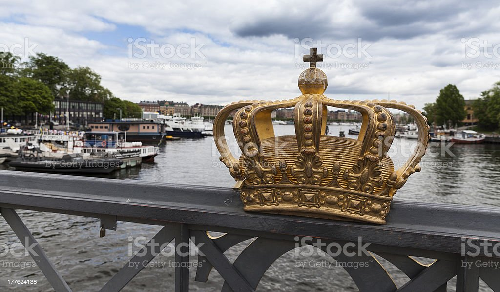 View of canal and bridge with royal crown in Stockholm stock photo
