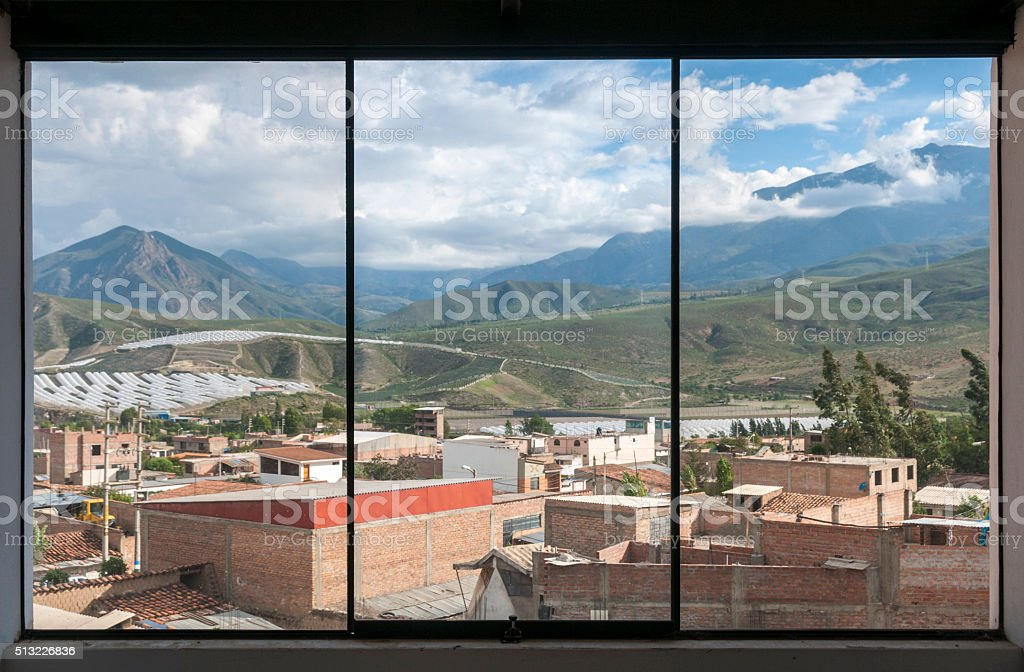 View Of Caraz Through A Window In The Peruvian Andes stock photo
