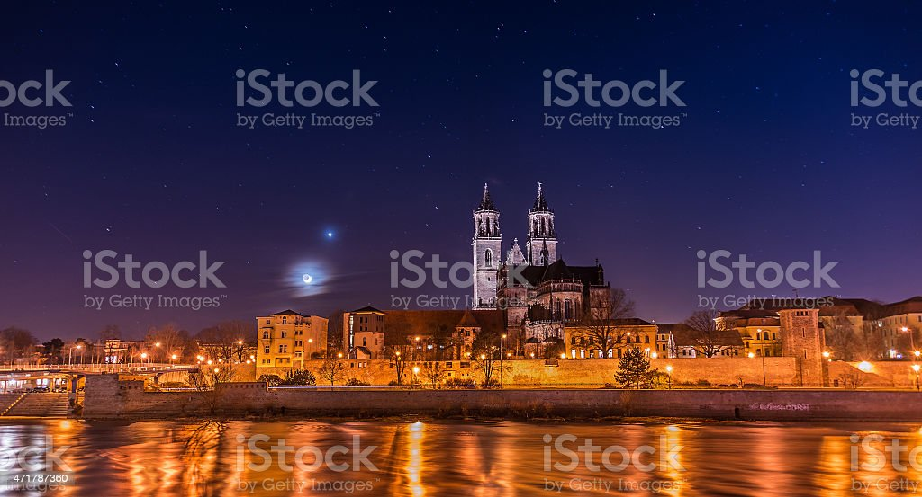 View of Cathedral of Magdeburg and river Elbe at night stock photo