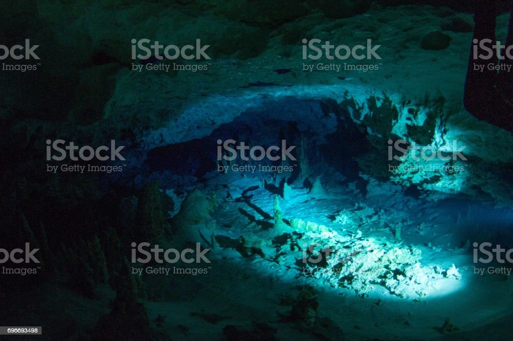 view of cavern diver flashlight view of stalactites and stalagmites stock photo
